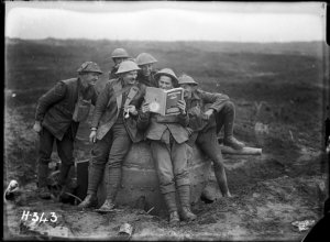 World War I New Zealand soldiers with a copy of 'New Zealand at the Front', 1917. Ref: 1/2-012980-G.